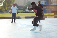 A hip hop dancer performs at The Oval, a public space pop-up on the Benjamin Franklin Parkway.