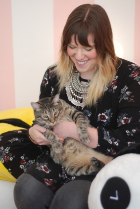 Kawaii Kitty Cafe's owner, Kristen Eissler, sitting in her cat cafe with her own cat, named Beef.