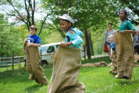 Children compete in a race during Fox Chase Farm's sheep sheering day in 2017.
