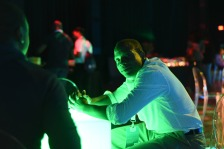 A man sits at a party hosted during the Project NorthStar Tech Conference in Philadelphia.